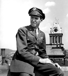09-24-1945 LIFE cover of uniformed pilot and actor, Col. Jimmy Stewart, sitting outside on top of bldg. in hometown, upon his return from WWII; photo by Peter Stackpole.