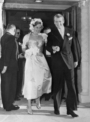 Brentwood, Los Angeles, California, USA --- 10/49-Brentwood, CA: Screen actor Jimmy Stewart gave up his battle with cupid and his title as number one bachelor when he slipped a wedding ring on the finger of socialite Gloria Hatrick McLean at the Brentwood Presbyterian Church. Photo shows Stewart and his bride as they leave the church after the ceremony while a crowd of between 500 and 600 milled quietly outside. --- Image by © Bettmann/CORBIS