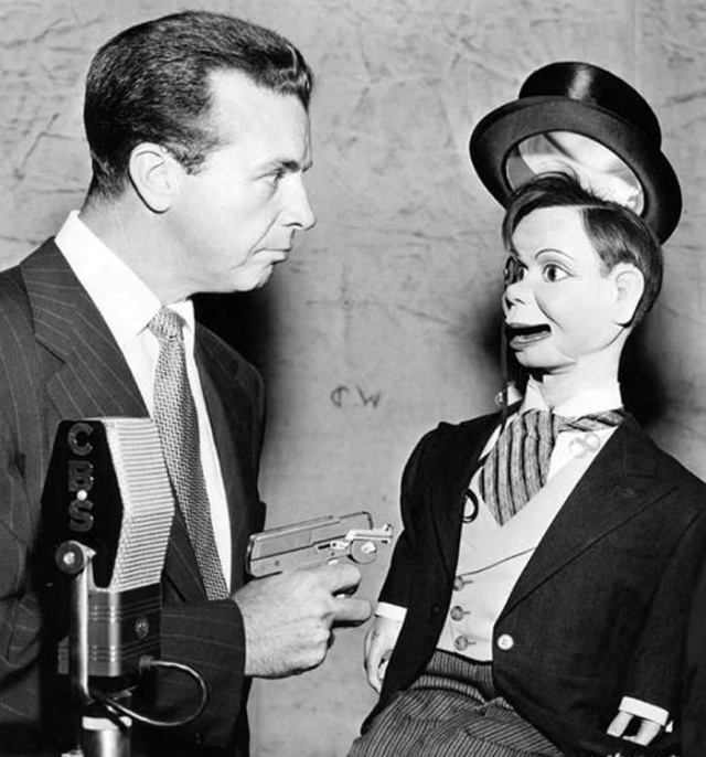 dick powell isn't taking any funny business from charlie mccarthy.jpg