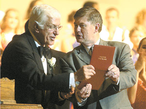 Van Dyke receives his high school diploma from Superintendent Gary Tucker after the performance. Van Dyke said he never picked up his diploma before going into the U.S. military in March of 1944. Photo by Matt Huber