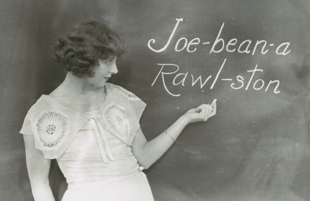 jobyna-ralston-silent-film-actress-and-harold-lloyds-main-leading-lady-phoenetically-writing-her-name-on-a-blackboard.jpg