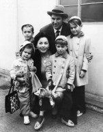 19 Dec 1954, London, England, UK --- Actress Jeanne Crain and her husband Paul Brinkman with their four children: Paul, Michael, Timothy and Jeanine at London Airport, 1954. --- Image by © Hulton-Deutsch Collection/CORBIS