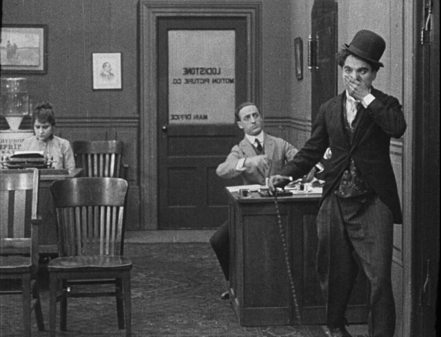 Gloria Swanson and Charlie Chaplin - His New Job (1915).png