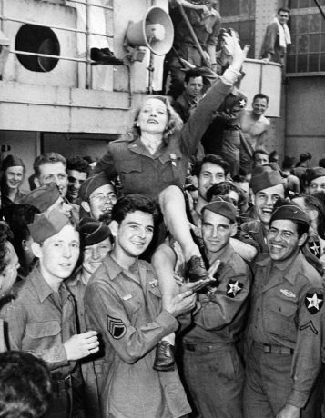 Movie actress Marlene Dietrich greets veterans on the Monticello after the ship docked in New York City on July 20, 1945 in World War II. (AP Photo)