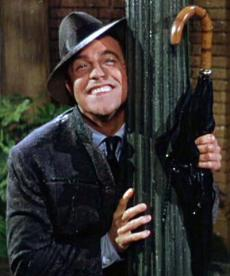Gene-Kelly-performing-the-title-number-singin-in-the-rain-34561274-400-480