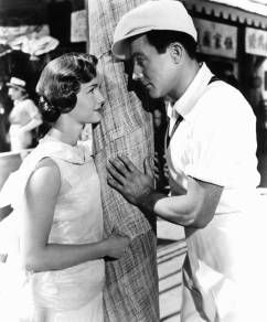 Debbie Reynolds looks at Gene Kelly in a scene from the film 'Singin' In The Rain', 1952. (Photo by Metro-Goldwyn-Mayer/Getty Images)