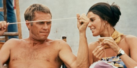 A shirtless Steve McQueen sitting next to Ali MacGraw on the set of the film 'The Getaway', 1972. (Photo by National General Pictures/Getty Images)