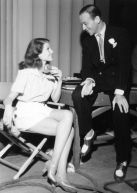 From left: co-stars Rita Hayworth and Fred Astaire relax between takes of YOU'LL NEVER GET RICH, 1941