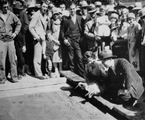 Norma Talmadge with Sid Grauman (above) leaving the very first foot and handprints on cement