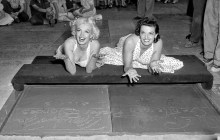 June 26, 1953. Actresses Marilyn Monroe, left, and Jane Russell after placing their handprints in wet cement at Grauman's Theater.