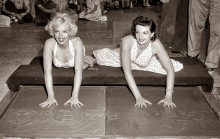 Marilyn Monroe and Jane Russell placing hand-prints in front of Grauman's theatre, 1953