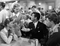 Susan-Turner-Shirley-Temple-and-Richard-Nugent-Cary-Grant-in-an-ice-cream-parlor-in-The-Bachelor-and-the-Bobby-Soxer