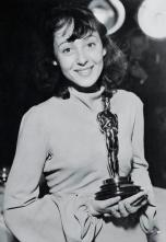 12 Mar 1938 --- Luise Rainer holds the 1937 Academy Award she received for her performance in The Good Earth. --- Image by © Bettmann/CORBIS