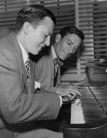 "The 1946 Academy Award®-winning film ""The Best Years of Our Lives"" featured Harold Russell and Hoagy Carmichael. Russell was a real-life war veteran who lost both his hands during the war when a defective fuse exploded in his grasp. Russell, who won the Supporting Actor Oscar® for his portrayal of Homer Parrish in the film, received an additional Oscar statuette as a Special Award for ""bringing hope and courage to his fellow veterans."" He and Carmichael, pictured here, played a piano duet in the film, which won the Oscar for Best Picture of 1946. Restored by Nick & jane for Dr. Macro's High Quality Movie Scans Website: http:www.doctormacro.com. Enjoy!"