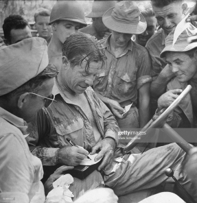 Comedian Joe E. Brown willingly signing autographs for troops after performance. (Photo by Frank Scherschel/The LIFE Picture Collection via Getty Images)