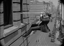 Harold-Lloyd-climbing-building-Safety-Last-1024x743
