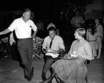 THE SOUND OF MUSIC, director Robert Wise, Christopher Plummer, Julie Andrews, on set, 1965. TM and Copyright (c) 20th Century Fox Film Corp. All rights reserved.