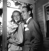 Newlywed actors Humphrey Bogart and Lauren Bacall attending wedding reception at home of novelist Louis Bromfeld.
