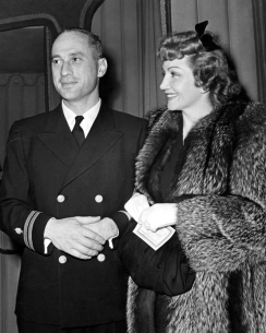 Naval officer JOEL PRESSMAN and wife CLAUDETTE COLBERT at Ciro's, 4/29/42